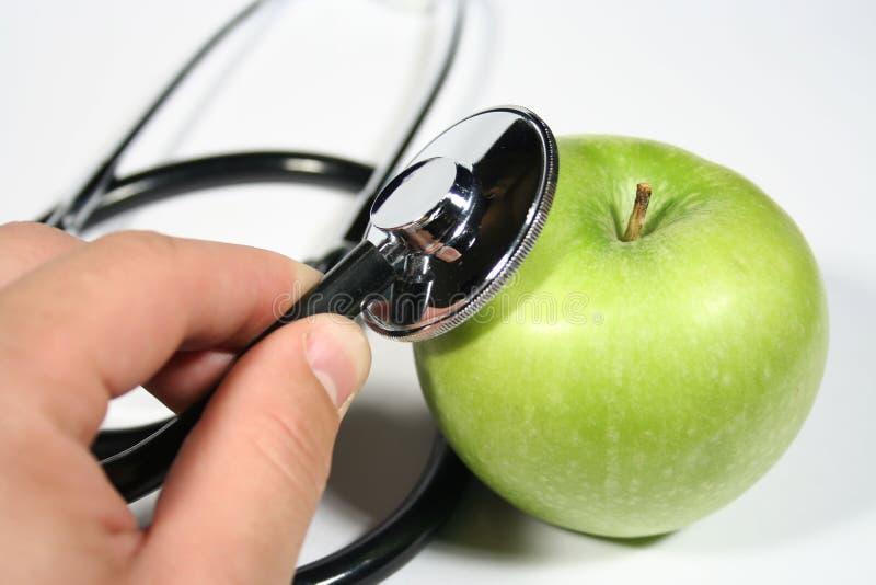 Una mela un il giorno fotografie stock