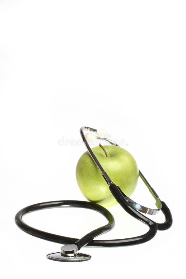 Una mela un il giorno II immagini stock libere da diritti