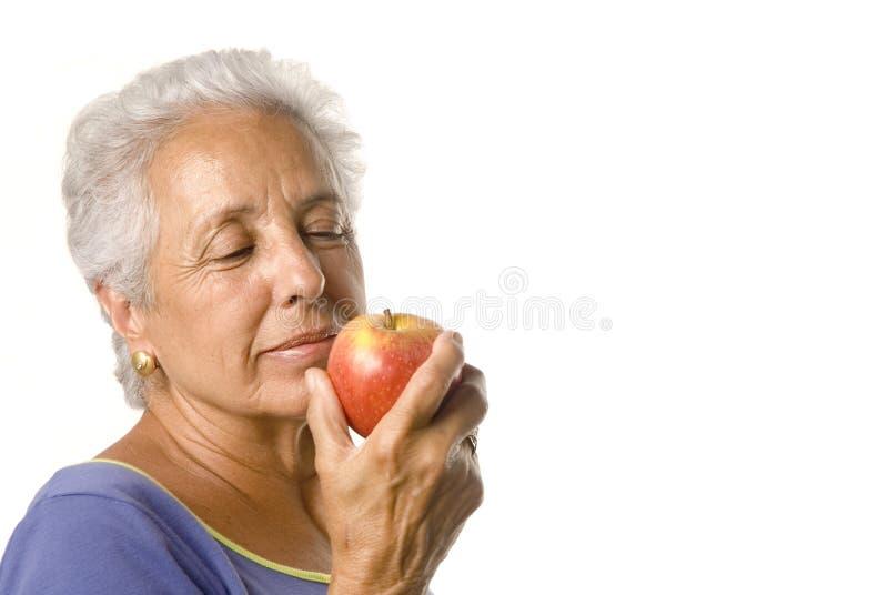Una mela un kepps di giorno ..... immagine stock