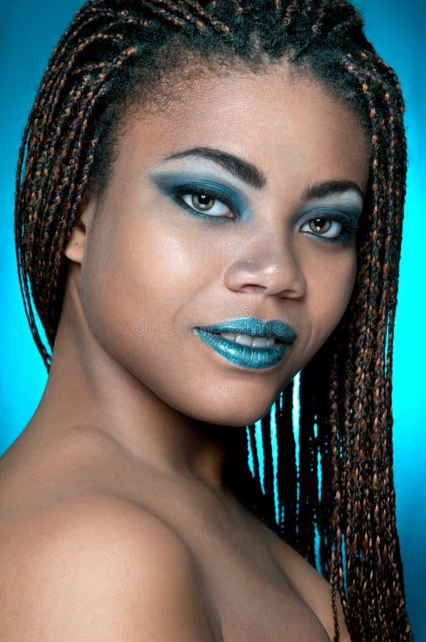 Una muchacha africana con los dreadlocks fotografía de archivo libre de regalías