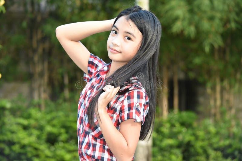 Una muchacha asiática hermosa foto de archivo