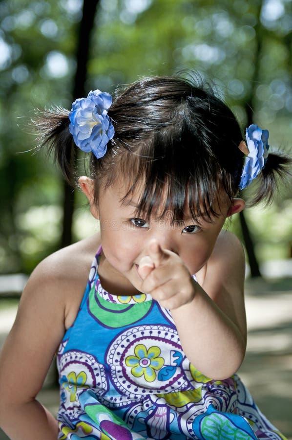 Una muchacha china encantadora imagenes de archivo