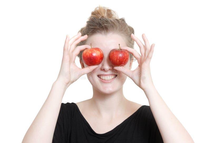 Una muchacha con las manzanas fotografía de archivo