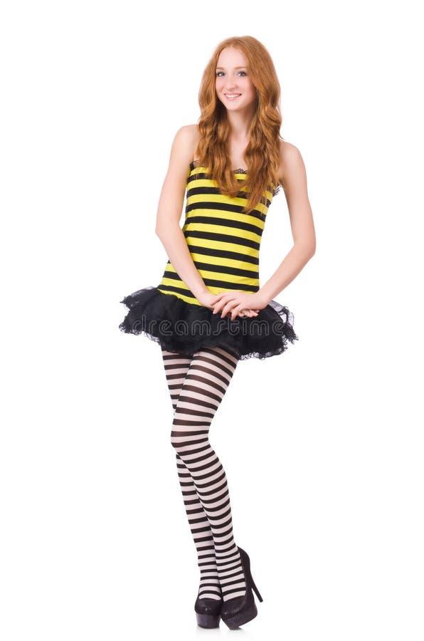 Una muchacha en el vestido rayado negro y amarillo aislado imagen de archivo
