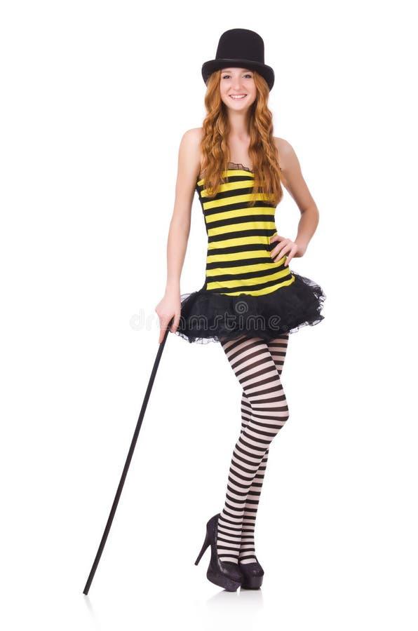 Una muchacha en el vestido rayado negro y amarillo aislado fotos de archivo