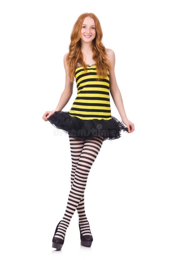 Una muchacha en el vestido rayado negro y amarillo aislado fotos de archivo libres de regalías