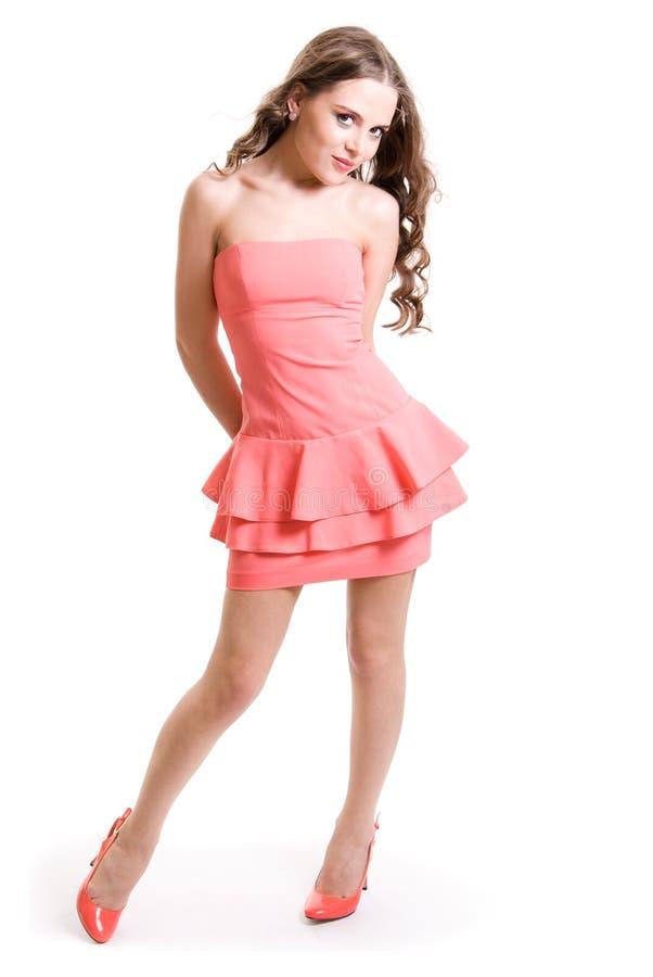 Una muchacha en una alineada rosada imágenes de archivo libres de regalías