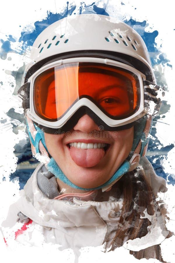 Una muchacha joven de la snowboard que llevaba un casco y los vidrios pusieron hacia fuera su lengua imagen de archivo libre de regalías