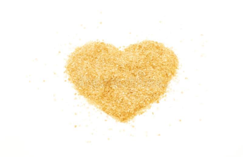 Una muestra del corazón por el azúcar marrón foto de archivo