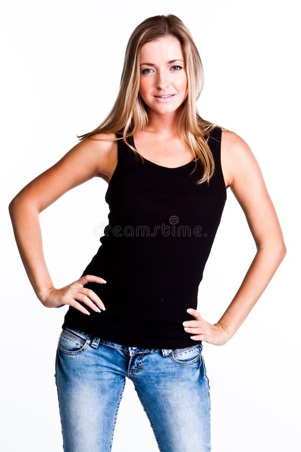 Una mujer en una camiseta negra fotos de archivo libres de regalías