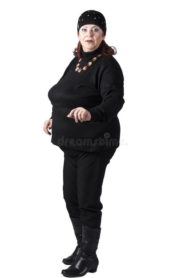 Una mujer gorda en un chándal foto de archivo