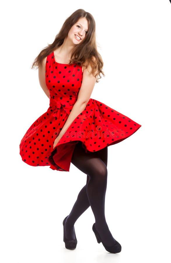 Una mujer hermosa joven está bailando imagenes de archivo