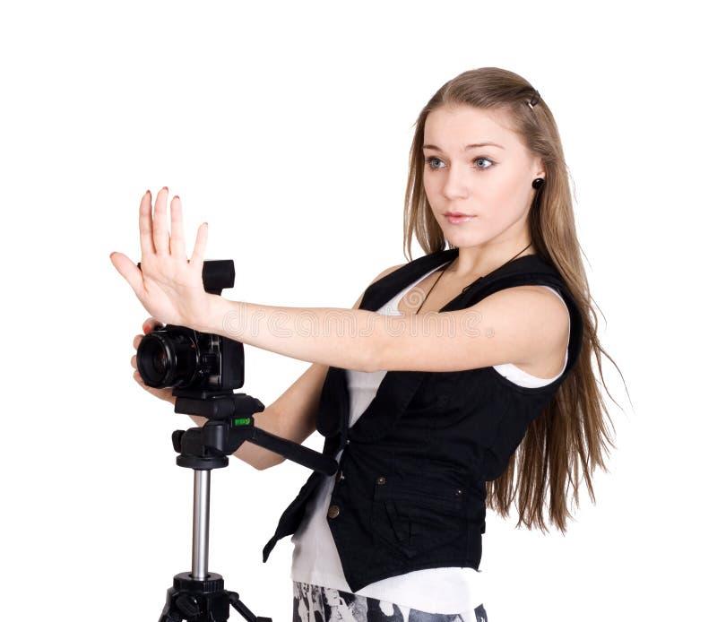 Una mujer joven con una cámara de la foto fotografía de archivo