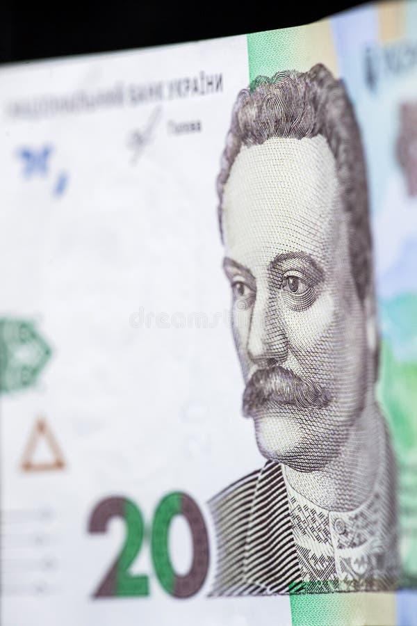 Una nuova denominazione della banconota di 20 UAH Fine ucraina dei soldi su fotografie stock libere da diritti