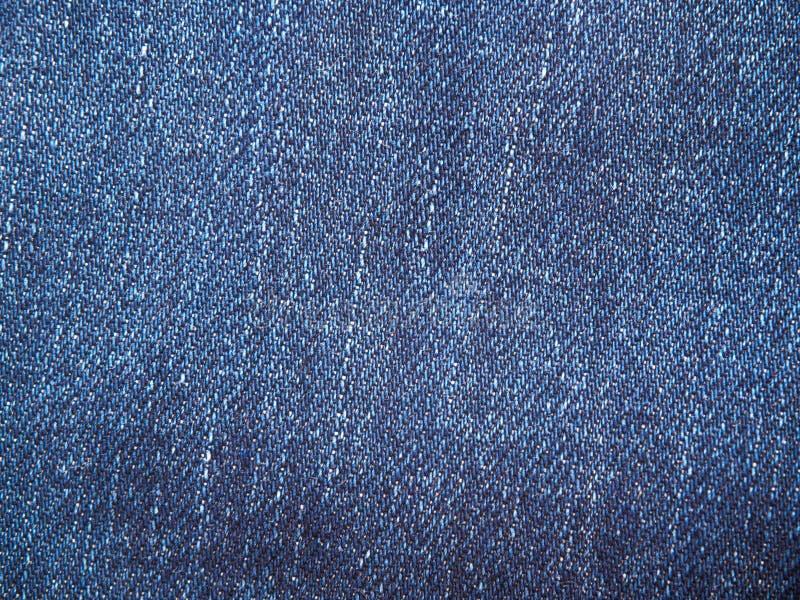 Una página completa del material de algodón azul, primer de la tela del dril de algodón Textura macra de la foto de los vaqueros  imagen de archivo