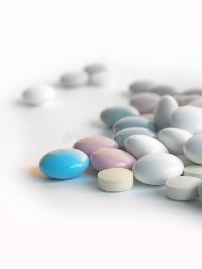 Una píldora azul fotografía de archivo libre de regalías