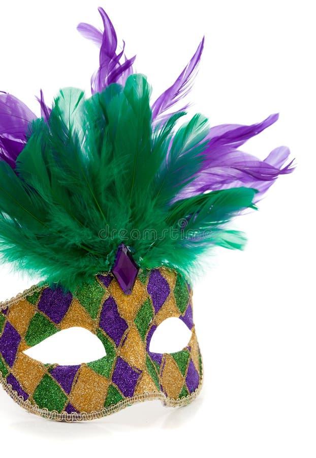 Una máscara multicolora del carnaval en un fondo blanco imágenes de archivo libres de regalías