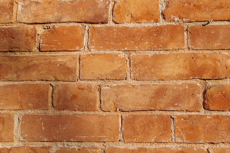 Una pared de ladrillo marrón al aire libre fotografía de archivo