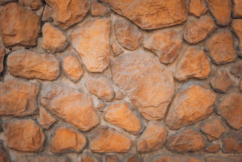 Una pared de rojo, ni siquiera piedra, en forma de pera foto de archivo