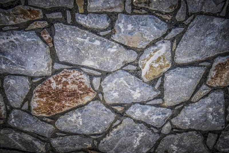Una parete di pietra fotografia stock libera da diritti