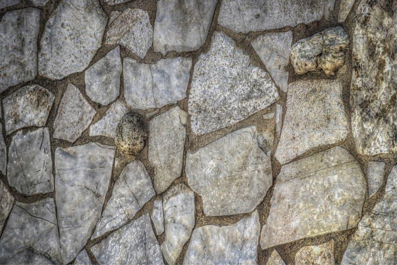 Una parete di pietra fotografie stock libere da diritti
