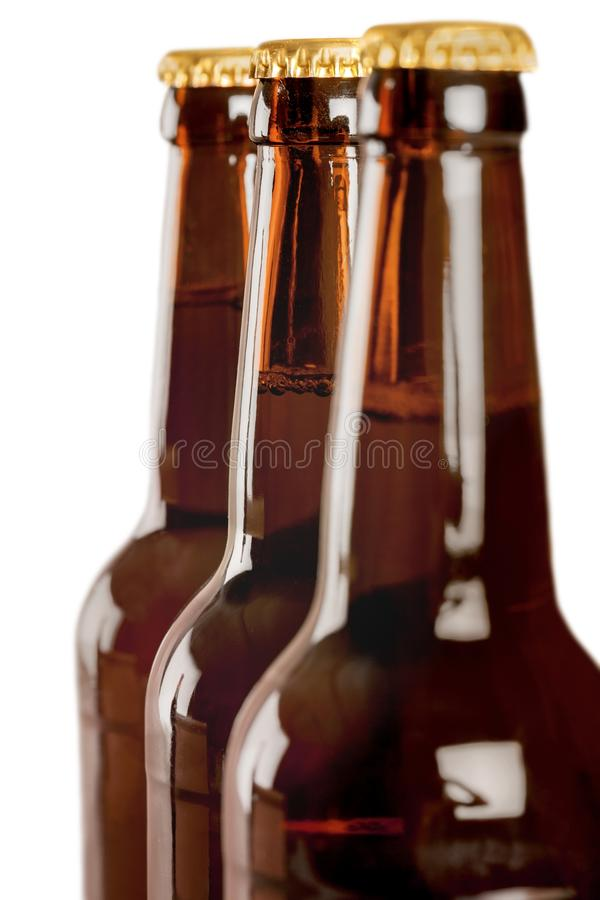 Download Una Parte Superiore Di Tre Bottiglie Da Birra Fotografia Stock - Immagine di back, bevanda: 117981040