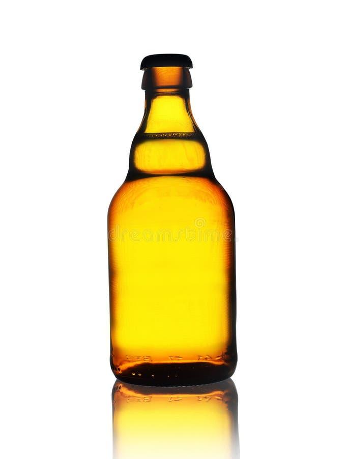 Una pequeña botella de cerveza fotografía de archivo