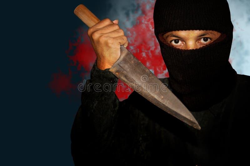 Una persona del asesino con sostenido fotografía de archivo libre de regalías
