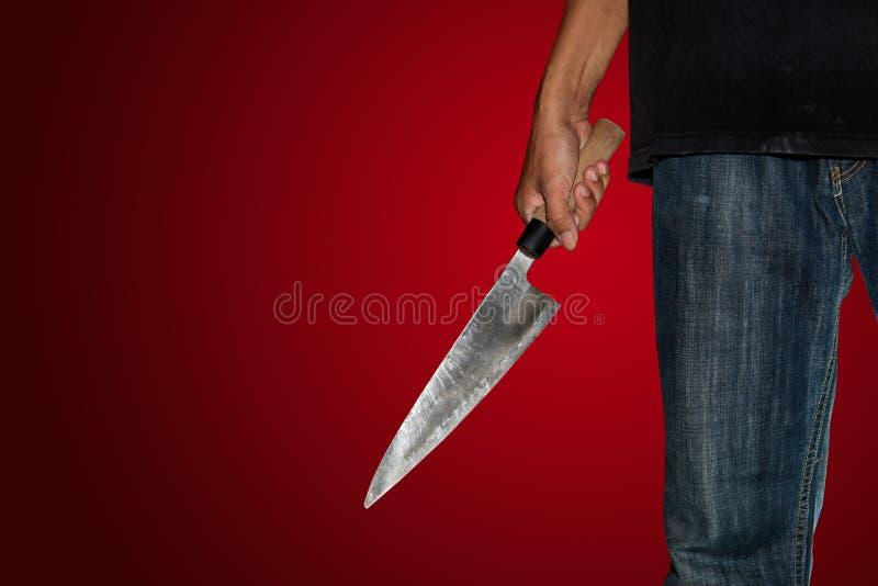 Una persona del asesino con sostenido imagen de archivo