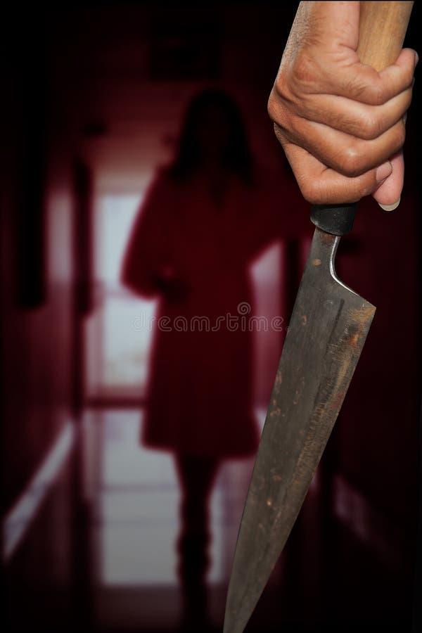 Una persona del asesino con sostenido imágenes de archivo libres de regalías