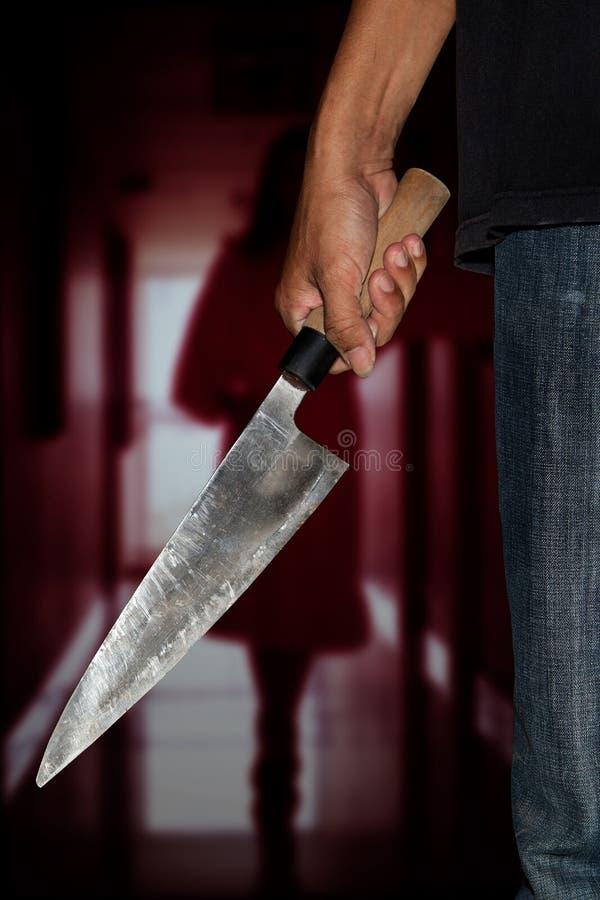 Una persona del asesino con sostenido imagenes de archivo