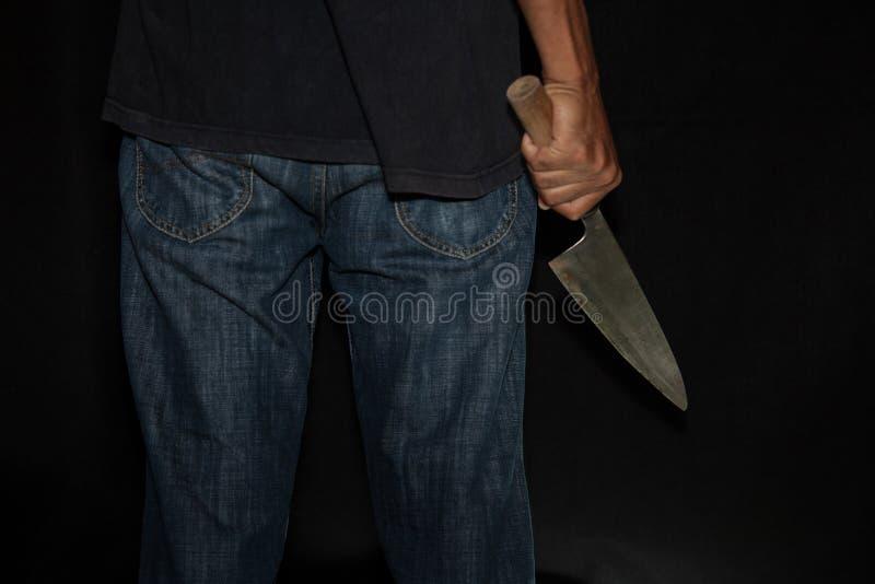 Una persona del asesino con sostenido foto de archivo libre de regalías