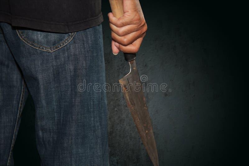 Una persona del asesino con sostenido foto de archivo