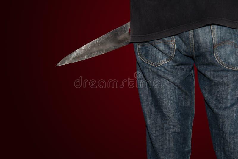 Una persona del asesino con sostenido fotos de archivo libres de regalías