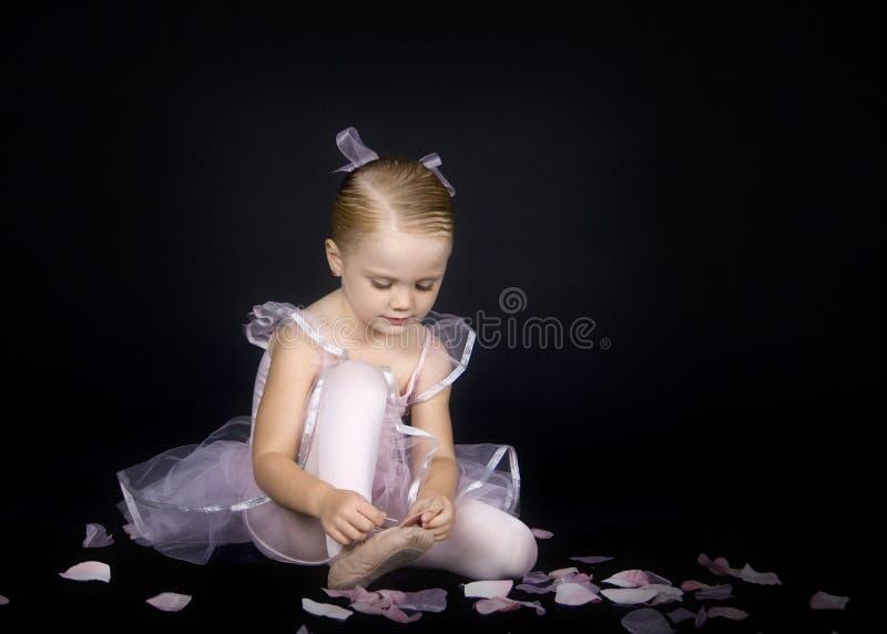 Una piccoli ballerina e pistone fotografia stock