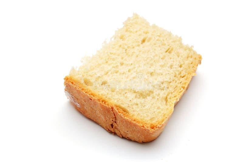 Una pieza del pan aislada foto de archivo