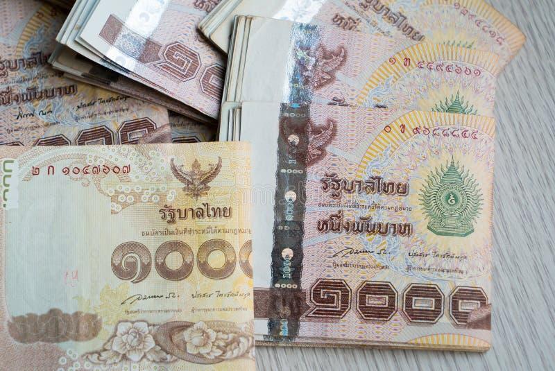 Una pila di mille soldi tailandesi del bagno fotografia stock libera da diritti
