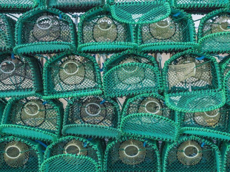 Una pila di nuove nasse per crostacei fotografie stock