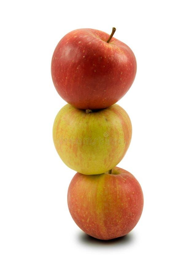 Una pila di tre mele immagini stock
