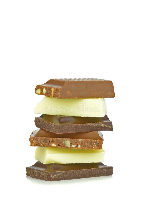 Una pila mista di bei pezzi del cioccolato immagini stock libere da diritti