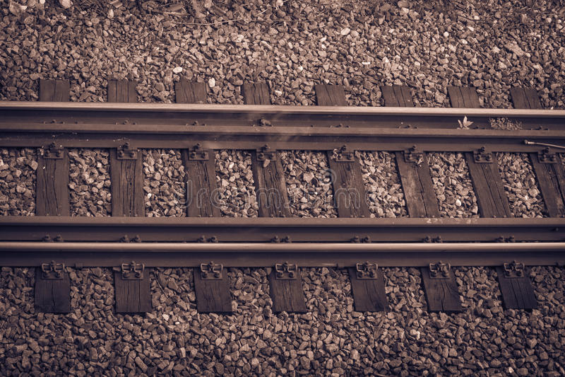 Una pista de ferrocarril coloreada sepia imagenes de archivo