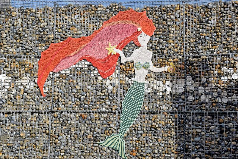 Una progettazione della sirena su una parete in Kent England immagine stock libera da diritti