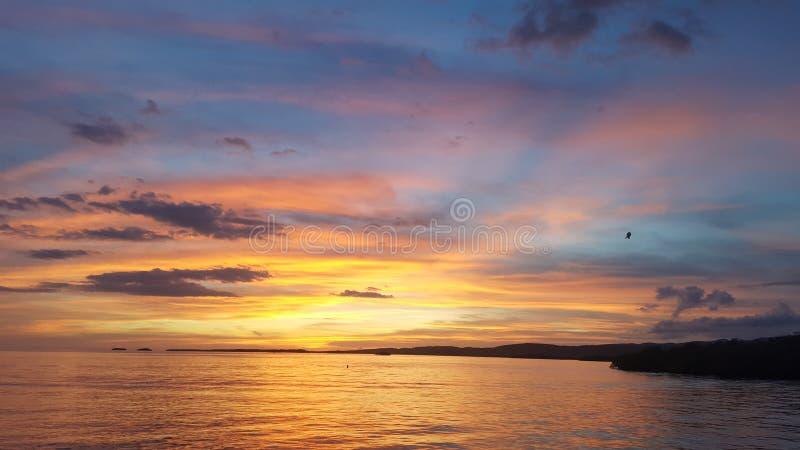 Una puesta del sol pintada fotografía de archivo libre de regalías