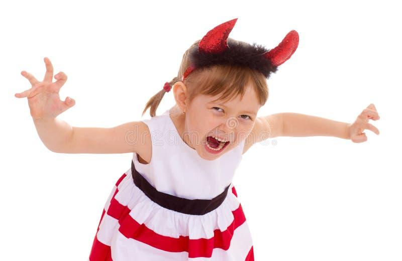 Una ragazza che indossa i corni capi. immagini stock libere da diritti