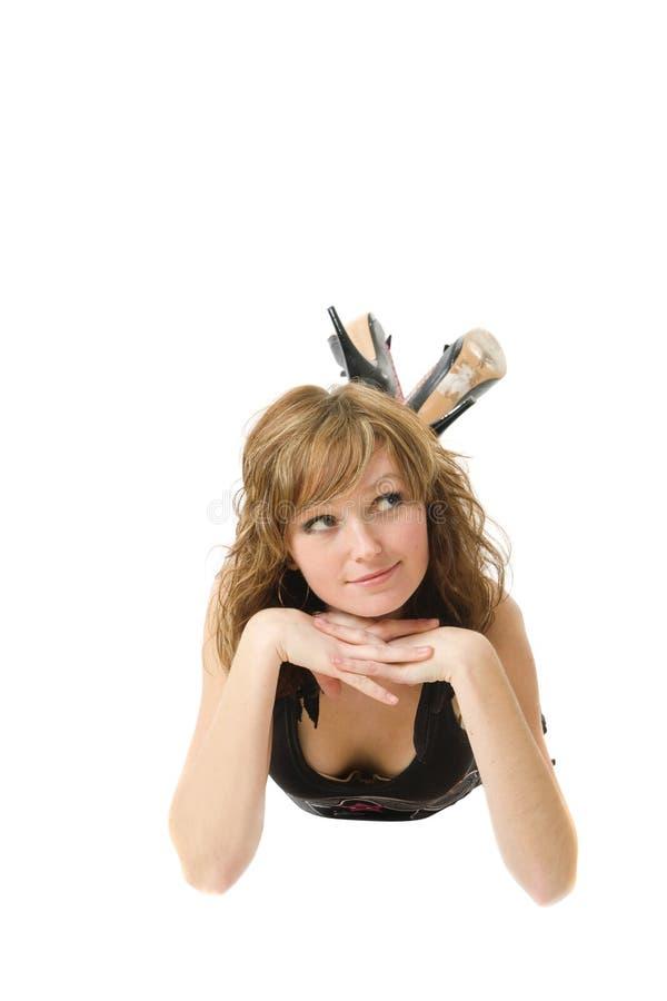 Una ragazza che si trova sul pavimento fotografie stock