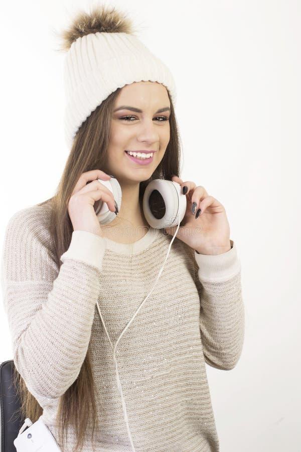 Una ragazza con le cuffie immagini stock libere da diritti