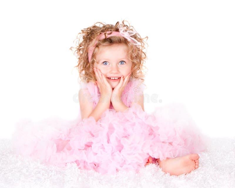 Una ragazza dai capelli riccia eyed blu del bambino immagine stock libera da diritti