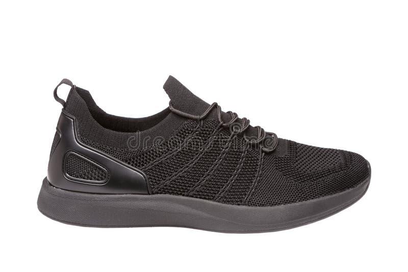 Una scarpa da tennis nera di estate, panno di maglia, su un fondo bianco fotografie stock libere da diritti