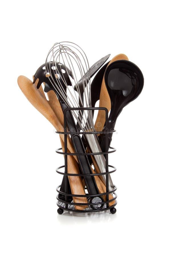 Una schiera degli utensili della cucina su bianco fotografie stock libere da diritti