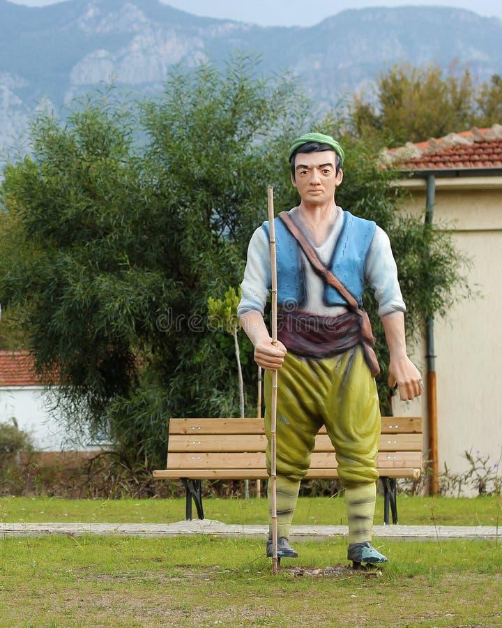Un parco turco del villaggio con le sculture (pastore) immagini stock